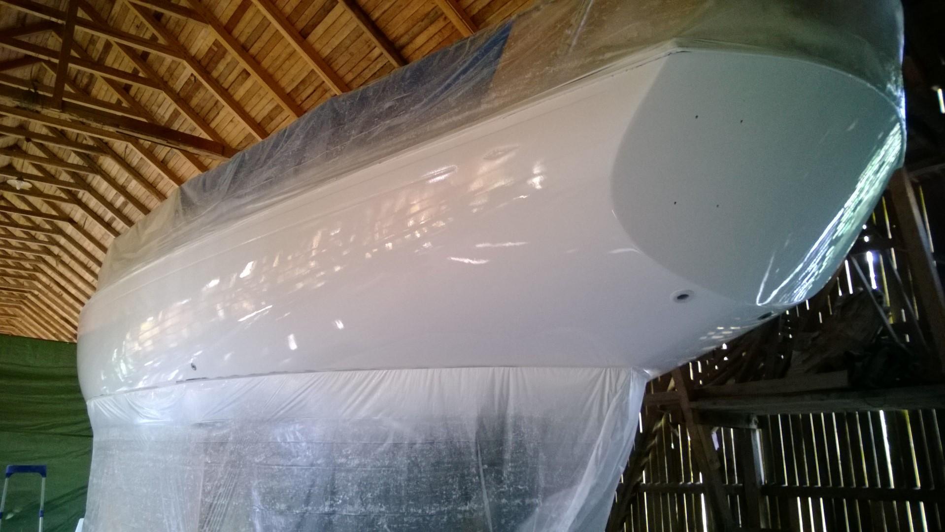 Teräsveneen maalaus  Portaiden teko rinteeseen